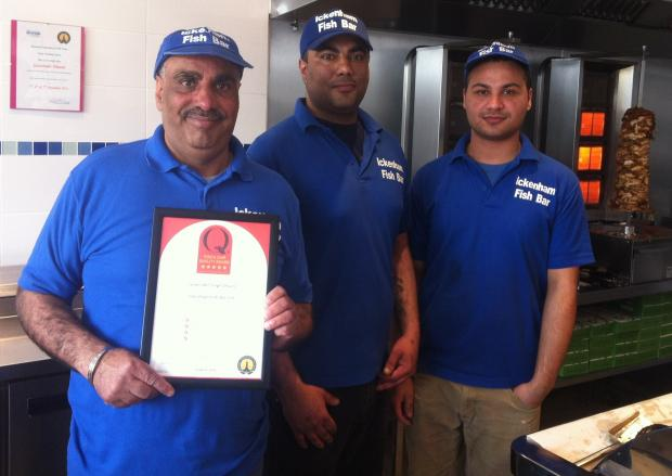 Plaice of honour: Jaswinder Jaswinder Dhami, left, with colleagues Nevejot Singh Dhami and Harry Singh