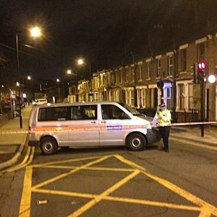 Hillingdon Times: Police at the scene in Hackney, east London, where a teenage girl has been shot