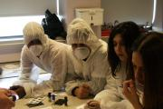 Uxbridge College students investigate a murder in the labs during Science & Engineering Week