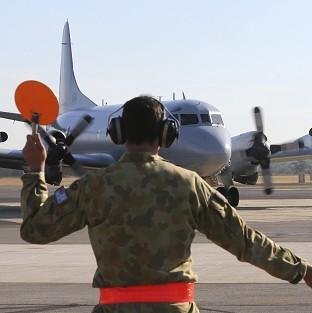 A Royal Australian Air Force AP-3C Orion returns to Perth after searching for the missing Malaysia Airlines plane (AP)