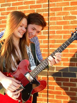 Striking a chord: singer Robbie with sweetheart Julia