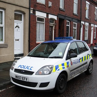 A police car outside the home of nurse Victorino Chua in Stockport when he was previously arrested