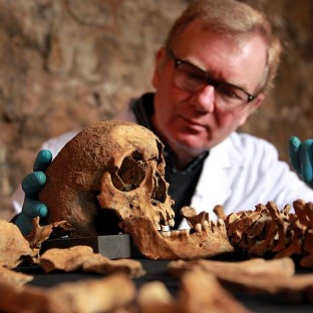 Hillingdon Times: Osteologist Don Walker with some of the skeletons that were discovered last year by Crossrail during construction works in Charterhouse Square