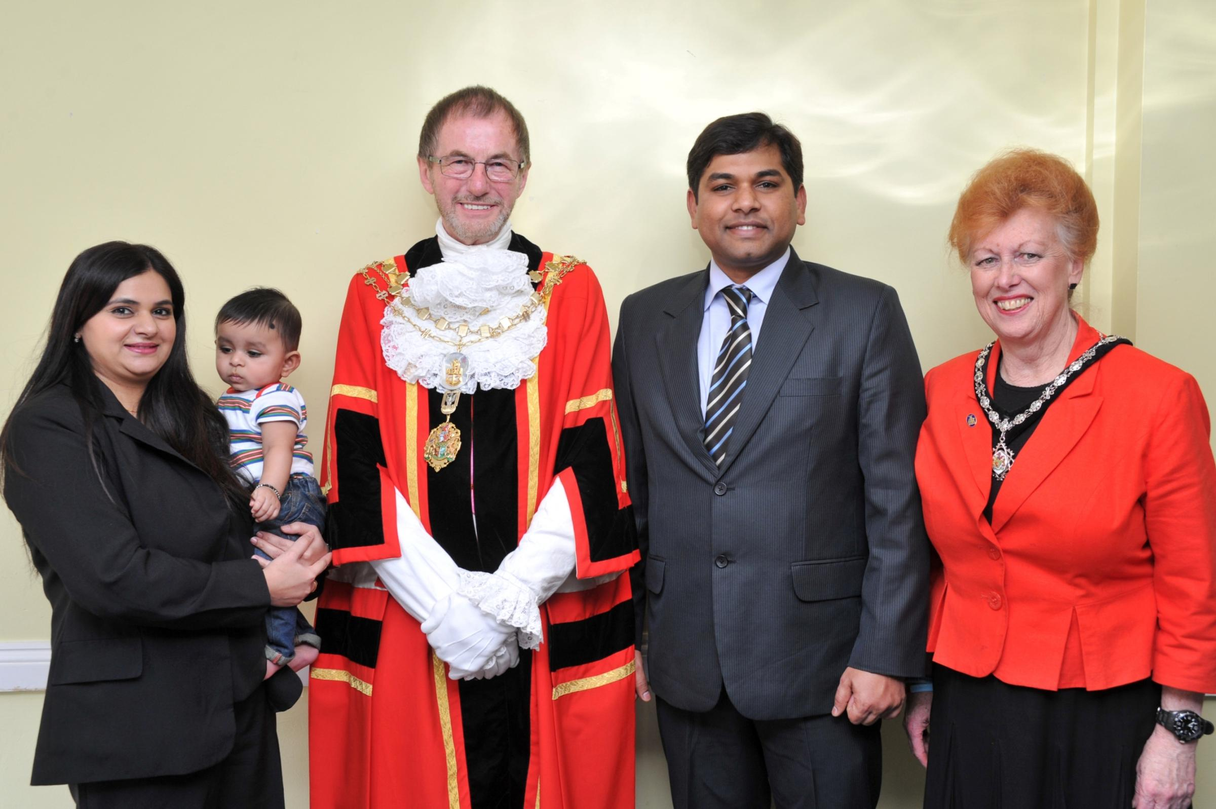 Welcome: the Nampally family with the Mayor and his wife Lynne. Photo by Mike Woollard of Paul Rose Photography