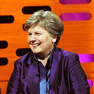 Comedienne Sandi Toksvig is collecting her OBE for services to broadcasting in a ceremony at Buckingham Palace