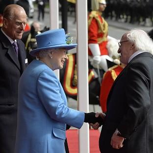 Hillingdon Times: President of Ireland Michael D Higgins is greeted by the Queen and Prince Philip outside Windsor Castle