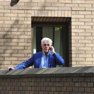 Hillingdon Times: Publicist Max Clifford makes a phone call during a break in his trial at Southwark Crown Court