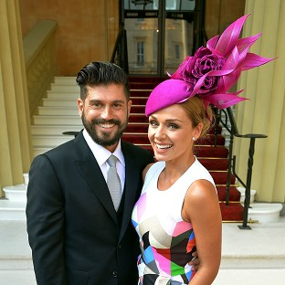 Katherine Jenkins and Andrew Levitas at Buckingham Palace when she received an OBE last month.