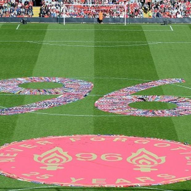Hillingdon Times: Fans' scarves make up a 96, filling the centre circle before the Hillsborough 25th Anniversary Memorial Service at Anfield Stadium, Liverpool