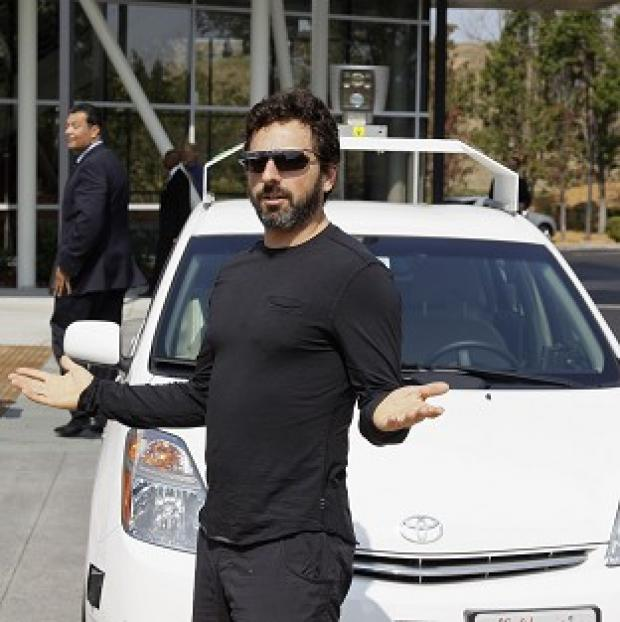 Hillingdon Times: Google co-founder Sergey Brin with a driverless car in Mountain View, California