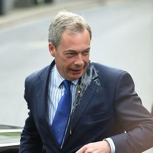 Ukip leader Nigel Farage was hit by an egg during a campaign visit to Nottingham