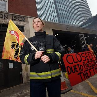Hillingdon Times: Firefighter Jes Bate at Euston fire station in London as firefighters staged a five hour strike in a row over pensions