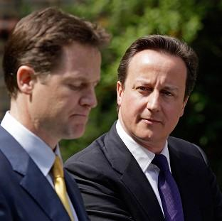 Prime Minister David Cameron, right, and Deputy Prime Minister Nick Clegg must agree on rules for the coalition's final year, a think tank said