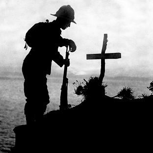 A British soldier pays his respects