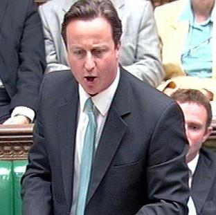 David Cameron speaks during Prime Minister's Questions in the House of Commons, London.
