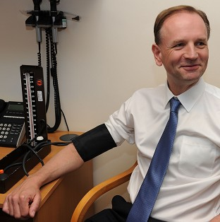 New NHS chief executive Simon Stevens, pictured having his blood pressure taken