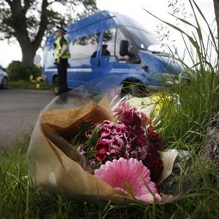 Hillingdon Times: Floral tributes near the scene at Little Swinton, near Coldstream, where three people were killed after a car lost control at the Jim Clark Rally in the Scottish Borders yesterday.