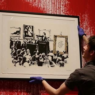 Banksy work Morons is going under the hammer.