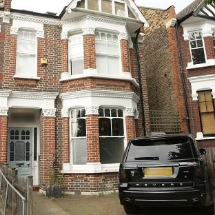 Hillingdon Times: The front of former footballer Ian Wright's house in London, where his wife and children were burgled at knifepoint.