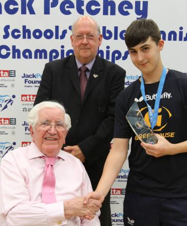 Table-topper: Mitchell with benefactor Jack Petchey, left, and Prof John Joughin, of UEL