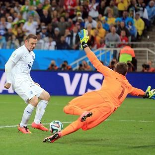 Wayne Rooney scores for England in the match against Uruguay