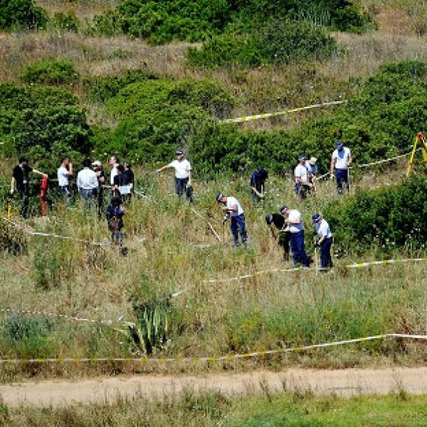 Hillingdon Times: British police and their Portuguese counterparts search a patch of scrubland on the Algarve