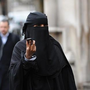 A woman wears a burka in London