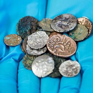 A hoard of Roman and Late Iron Age coins which were discovered in t