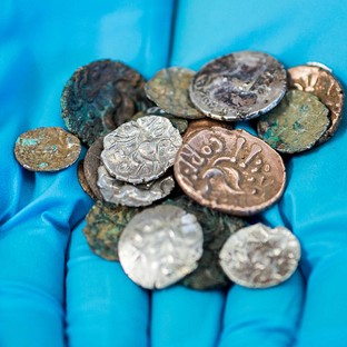 A hoard of Roman and Late Iron Age coins which were discovered in the Reynard's Cave and Kitchen cavern in Dovedale in the Peak District (National Trust)