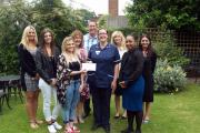 Uxbridge College and Basepoint business centres joined forces to raise more than £1,000 for Michael Sobell Hospice. The cheque was presented in the hospice's peaceful garden.