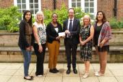 Photo caption: Harlington Hospice's Kathryn Underwood (second left) and Steve Curry (centre), met students Divya Bajaj, 19, and Isra Iqbal, 19, event organiser Enkema Futsum and Lorraine Collins, Executive Director - Enterprise & Development at Uxbridge
