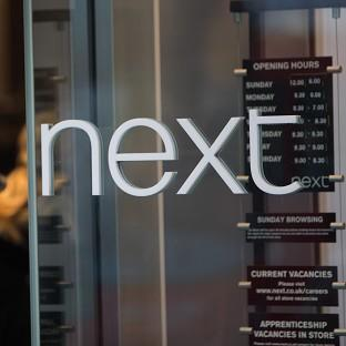 Next says it is on course for full-year profits of between £775m and £815m