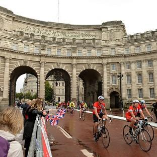 Cyclists make their way through Admiralty Arch