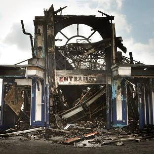 The man who died had been working on Eastbourne Pier, which was damaged by fire last month