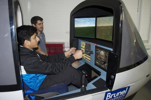 Flight control: a pupil tries out a simulator at Brunel