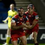 Hillingdon Times: Salford forward Weller Hauraki, left, celebrates his try against Widnes