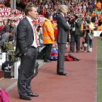 Hillingdon Times: Brendan Rodgers, who has been sacked by Liverpool, stands with Arsenal manager Arsene Wenger during a league match at Anfield last year