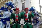 Parading ice creatures and jumping elves entertain the crowd in Uxbridge