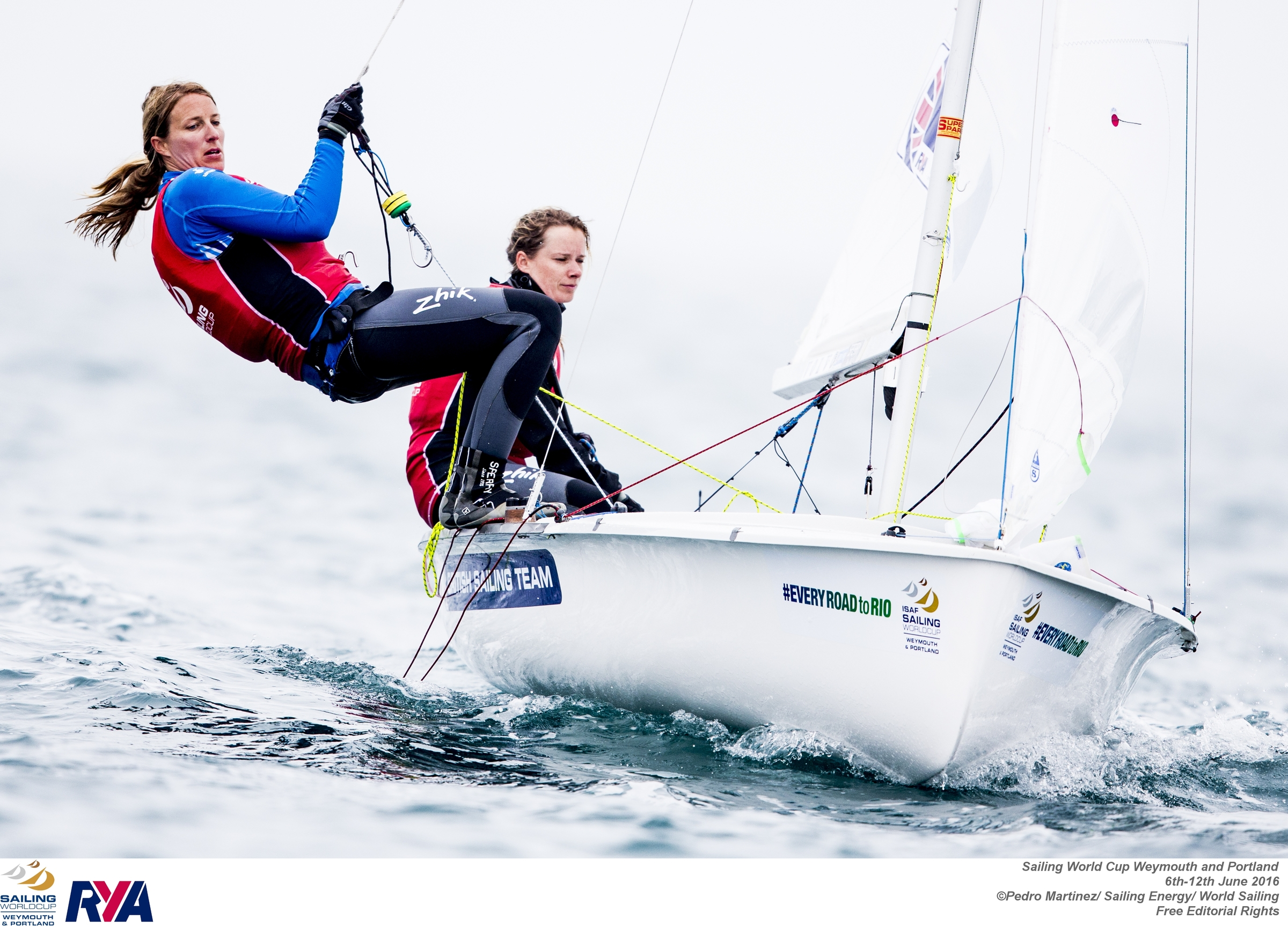 Saskia Clark (left) and Hannah Mills are well-placed at the Sailing World Cup in Weymouth but ready for the pressure of trying to record a home win