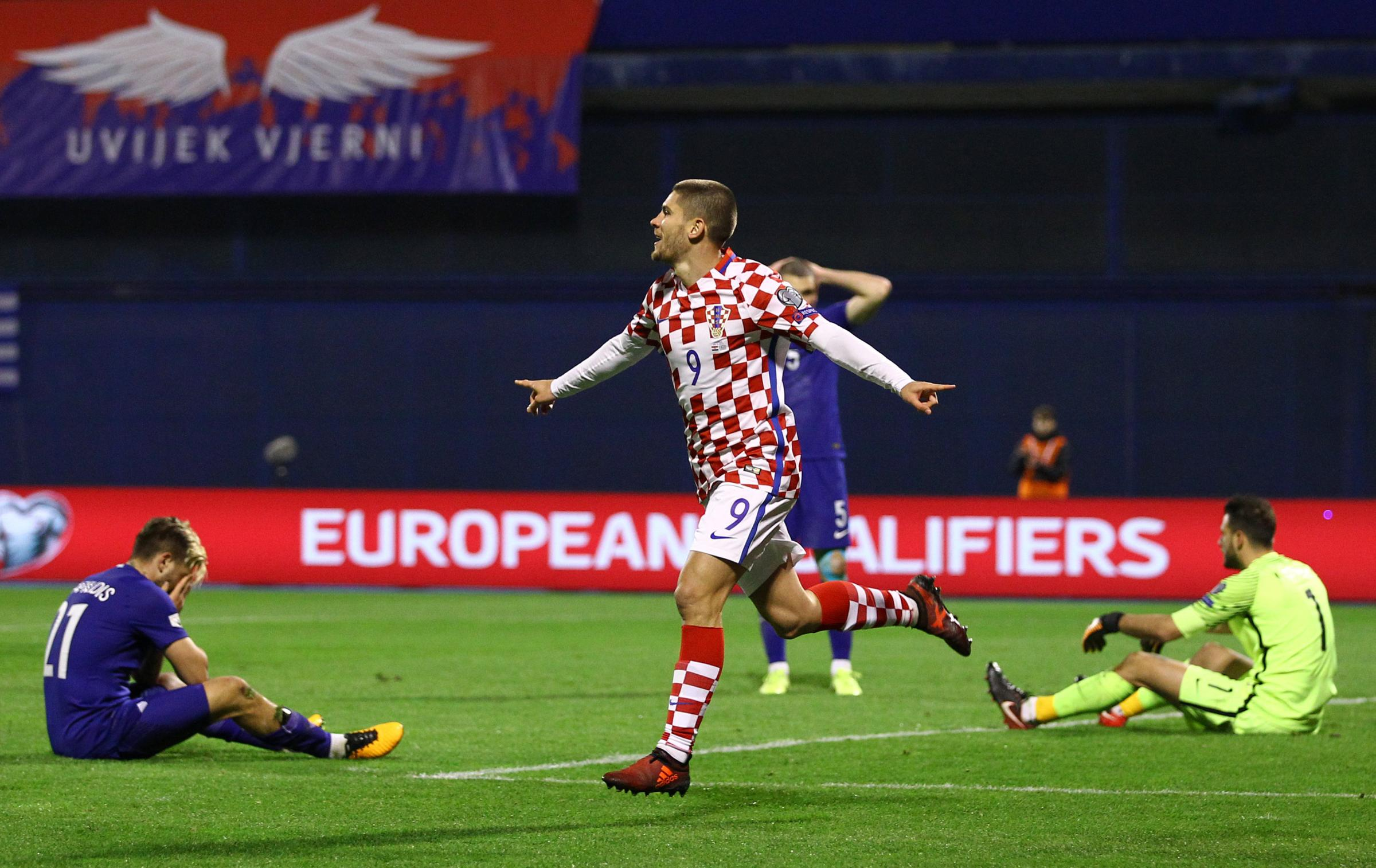 Orestis Karnezis is left sat on the ground as Andrej Kramaric celebrates scoring Croatia's fourth. Picture: Action Images