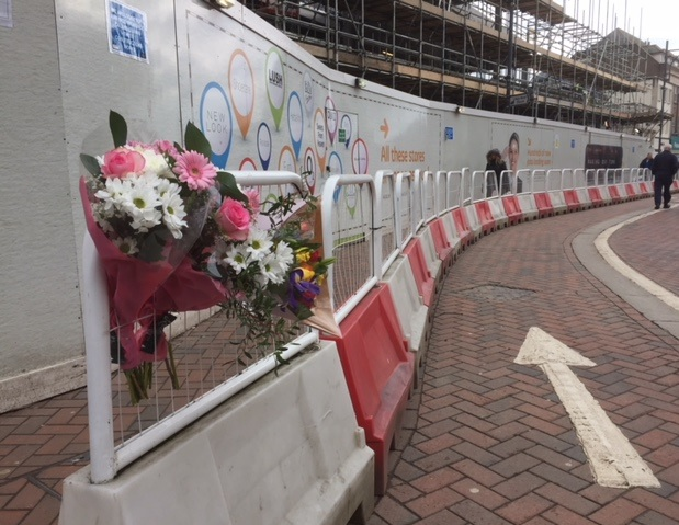 Flowers at the scene at Watford High street