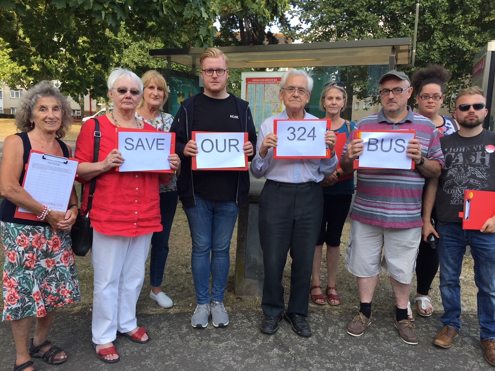 Campaigners outside a bus stop on the Meriden estate including John Dowdle (holding the 324 card)