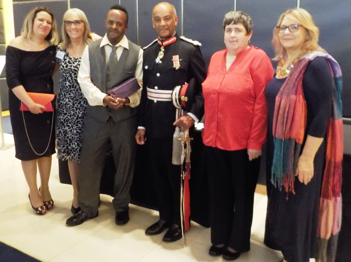 Honoured: IMPACT members with Kenneth Olisa