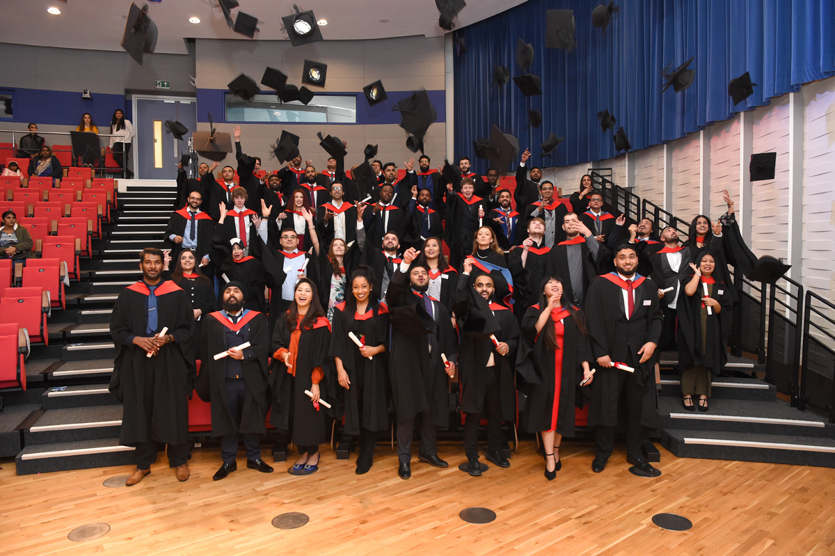 Uxbridge College HNC & HND achievers celebrate their graduation at Brunel University London with the traditional custom of throwing their mortar boards in the air