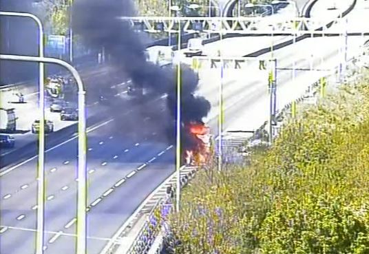 Black smoke billowed into the air after a vehicle fire on the M25. Photo: Highways England